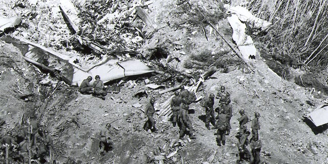 Air Disaster - Rescue workers search for survisors of the Japan Air Lines 747 jetliner that crashed Monday night, August 12, 1985 into a mountain in central Japan. The plane crashed into remote mountains making rescue efforts difficult. The AP-Photo shows rescue operations conducted by the Japan Self Defense Forces on August 13th. (AP-Photo)