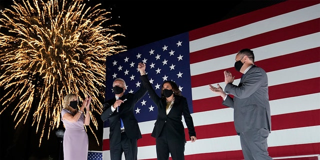 Democratic presidential candidate former Vice President Joe Biden, and his wife Jill Biden, watch fireworks with Democratic vice presidential candidate Sen. Kamala Harris, D-Calif., and her husband Doug Emhoff, during the fourth day of the Democratic National Convention, Thursday, Aug. 20, 2020, at the Chase Center in Wilmington, Del. (AP Photo/Andrew Harnik)