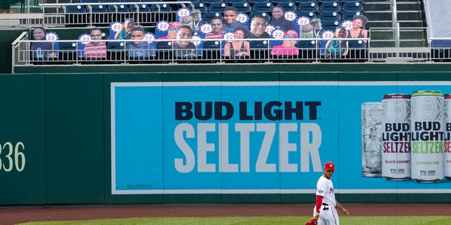 Washington Nationals left fielder Juan Soto walks near cut-outs with number 22 on the bleacher during the first inning of a baseball game against the New York Mets in Washington, Wednesday, Aug. 5, 2020. (AP Photo/Manuel Balce Ceneta)