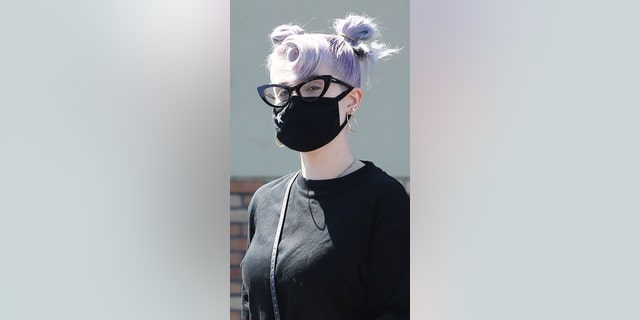 35-year-old television personality Kelly Osbourne left a CVS pharmacy in Los Angeles on Wednesday showing off her slim figure.