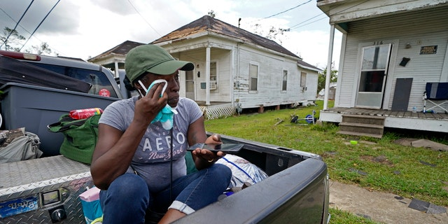 Linda Smoot, who evacuated from Hurricane Laura in a pickup truck with eight others, reacts as they return to see the damaged home of her niece for the first time, in Lake Charles, La., in the aftermath of the hurricane, Sunday, Aug. 30, 2020.