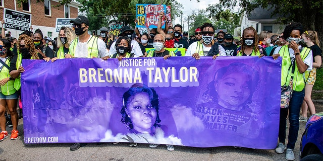 Protesters participate in the Good Trouble Tuesday march for Breonna Taylor, on Tuesday, Aug. 25, 2020, in Louisville, Ky. (Amy Harris/Invision/AP)