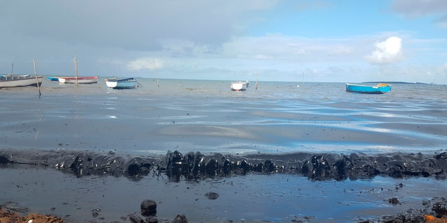 Oil is seen polluting the shores of the public beach in Riviere des Creoles, Mauritius, on Saturday. (Sophie Seneque via AP)