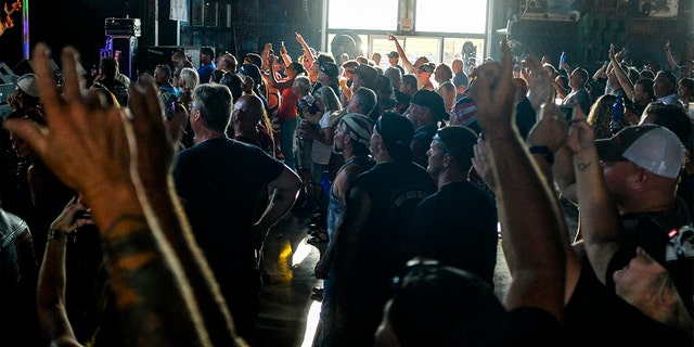 People cheer during a concert at the Full Throttle Saloon during the 80th Annual Sturgis Motorcycle Rally on August 7, 2020 in Sturgis, South Dakota. While the rally usually attracts around 500,000 people, officials estimate that more than 250,000 people may still show up to this year's festival despite the coronavirus pandemic.