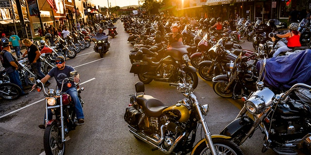 Motorcyclists drive down Main Street during the 80th Annual Sturgis Motorcycle Rally on August 7, 2020 in Sturgis, South Dakota. (Photo by Michael Ciaglo/Getty Images)