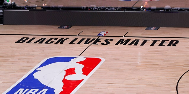 Black Lives Matter was a mainstay message on NBA courts over the summer. (Kevin C. Cox/Pool Photo via AP)