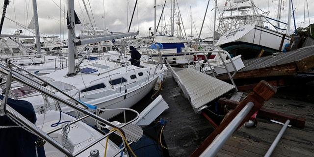 Boats are piled on each other in the marina following the effects of Hurricane Isaias in Southport, N.C., Tuesday, Aug. 4, 2020.