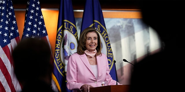 House Speaker Nancy Pelosi of Calif., speaks during a news conference on Capitol Hill in Washington, Aug. 22. The House is set for a rare Saturday session to pass legislation to halt changes in the Postal Service and provide $25 billion in emergency funds. (AP Photo/Susan Walsh)