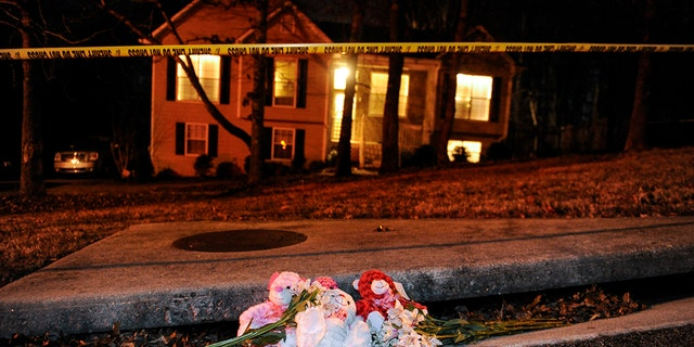 A makeshift memorial is shown outside a home in a suburban neighborhood in Douglasville, Georgia, February 7, 2015. At least seven people were shot in the community west of Atlanta on Saturday in an attack that left five people dead, local media reports. REUTERS/John Amis (UNITED STATES - Tags: CRIME LAW) - TM3EB271MGP01