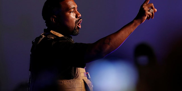 Rapper Kanye West gestures to the crowd as he holds his first rally in support of his presidential bid in North Charleston, S.C., U.S. July 19. REUTERS/Randall Hill