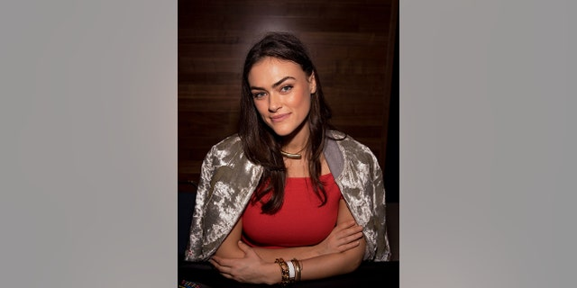 SI Swimsuit model Myla Dalbesio signs autographs during the VIBES by Sports Illustrated Swimsuit 2017 launch festival on February 17, 2017, in Houston, Texas.