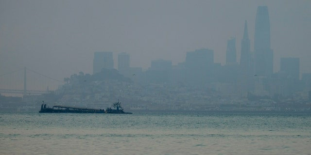 The San Francisco skyline is barely visible through smoke from wildfires Wednesday, Aug. 19, 2020, in this view from Sausalito, Calif.