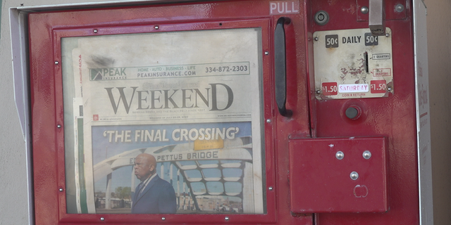A newspaper in Selma featuring John Lewis on the cover.