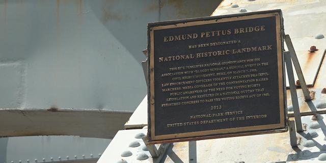 A plaque mounted on the Edmund Pettus Bridge.
