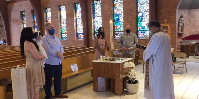 Julia Vicidomini and her family attend her daughter's baptism at Christ the King Church in Hillside, N.J.