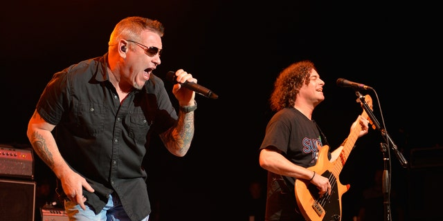 Singer Steve Harwell and bassist Paul de Lisle of Smash Mouth perform during the Under The Sun Tour at The Greek Theatre on August 12, 2014 in Los Angeles, California. (Photo by Michael Tullberg/Getty Images)