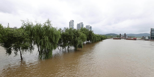 A part of a park near Han river is flooded after heavy rain in Seoul, South Korea, Sunday, Aug. 2, 2020.