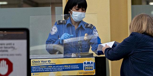 A Transportation Security Administration (TSA) screening a traveler at Ronald Reagan National Airport (DCA) in Arlington, Virginia, on Tuesday, June 9, 2020. (Andrew Harrer/Bloomberg via Getty Images)