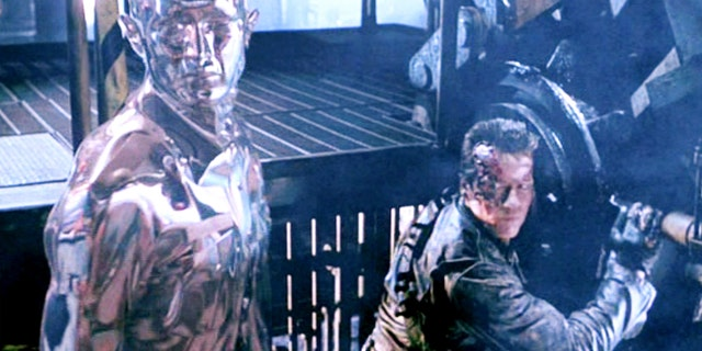 "The movie ""Terminator 2: Judgment Day"", directed by James Cameron. Seen here from left, the T-1000 Terminator, in liquid metal form, and Arnold Schwarzenegger (as the T-800 Terminator). Screen capture. Paramount Pictures."