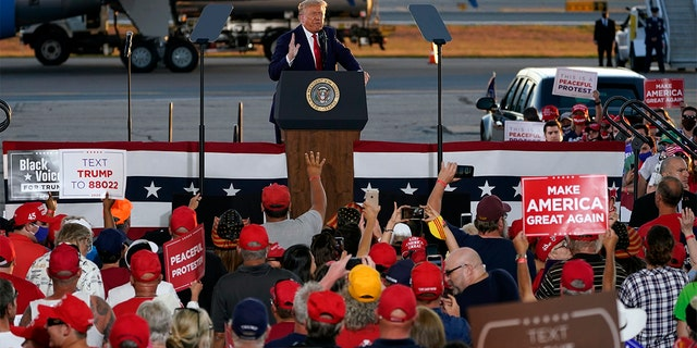 President Donald Trump speaks during a campaign rally at Manchester-Boston Regional Airport, Aug. 28, in Londonderry, N.H. (AP Photo/Charles Krupa)