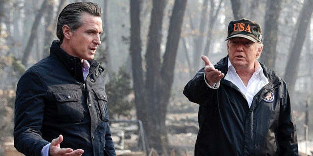 In this Nov. 17, 2018 photo, President Trump talks with then Gov.-elect Gavin Newsom, left, during a visit to a neighborhood impacted by the wildfires in Paradise, Calif. (AP Photo/Evan Vucci, File)