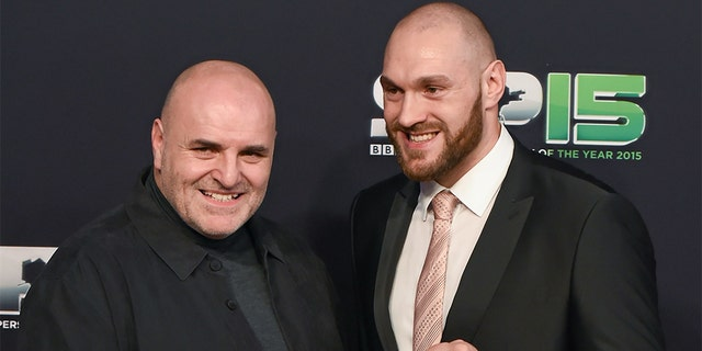 Boxer Tyson Fury and his father, John, arrive to BBC Sports Personality of the Year 2015 at the Titanic Belfast, Titanic Quarter, Olympic Way, Belfast, Co Antrim. Picture credit: Stephen McCarthy / SPORTSFILE