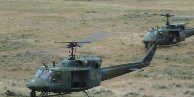 A UH-1N helicopter, seen here in a file image, made an emergency landing after it was struck by a bullet Monday.