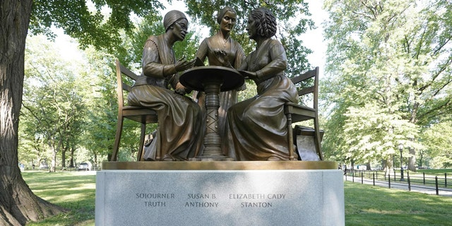 FILE -- The unveiling of the statue of women's rights pioneers Susan B. Anthony, Elizabeth Cady Stanton and Sojourner Truth is seen in Central Park in New York on August 26, 2020, marking the park's first statue of real-life women. (Photo by TIMOTHY A. CLARY/AFP via Getty Images)