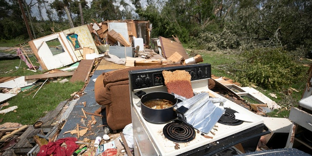 A stove with a pot still on a burner remains intact, while the rest of the mobile home was destroyed by a tornado, spawned by Hurricane Isaias, on Morning Road on Wednesday, August 5, 2020 in Bertie County, N.C.