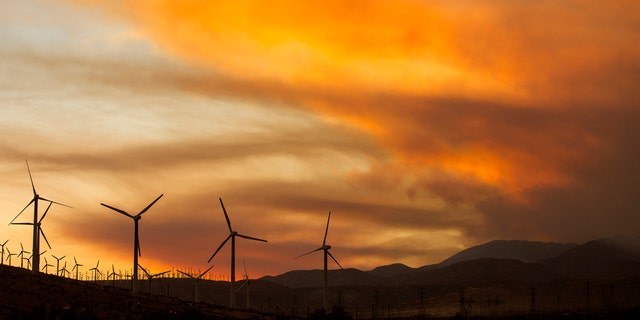 Smoke rise from the Apple Fire during the sunset near Whitewater, Calif., Sunday, Aug. 2, 2020.