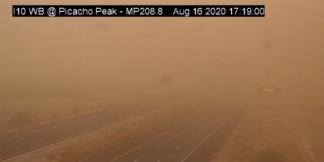 A dust storm can be seen on Sunday, Aug. 16, 2020 on Interstate 10 near Picacho Peak, Arizona.