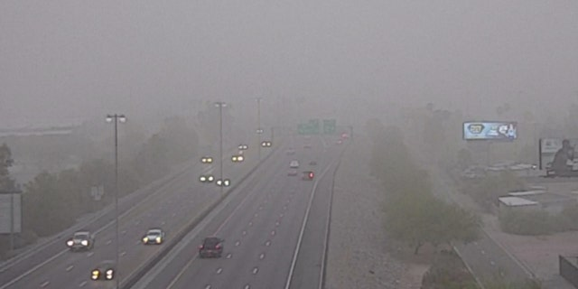 Motorists drive through the dust along Interstate 17 in Phoenix on Aug. 16, 2020.