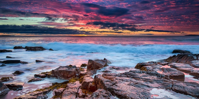 A beautiful sunrise at the rocky beach of Thunder Hole in Acadia National Park, Maine, USA.