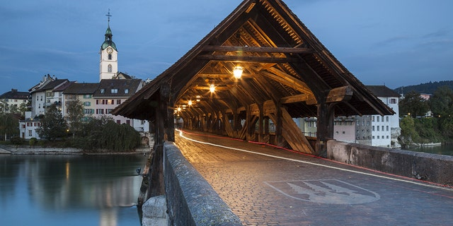 Covered bridge over Aare river in Olten at dawn. (Photo by: Loop Images/Universal Images Group via Getty Images)