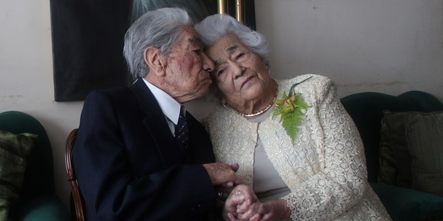 Couple Julio Mora Tapia, 110, and Valdramina Quinteros, 104, both retired teachers, pose for a photo at their home in Quito, Ecuador, on August 28 (AP Photo / Dolores Ochoa)