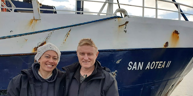 Neville and Feeonaa Clifton are pictured by the San Aotea II fishing boat in the Falkland Islands before embarking on their journey in July. (AP/Feeonaa and Neville Clifton)
