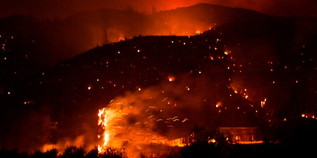 The Lake Hughes fire burns in Angeles National Forest on Thursday, Aug. 13, 2020, north of Santa Clarita, Calif.