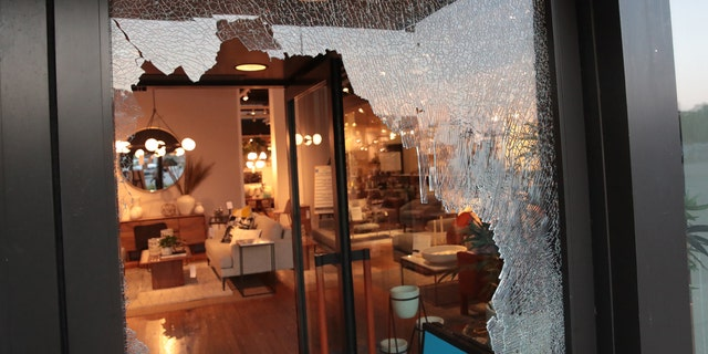 A broken storefront window is seen in Chicago early Monday. (Getty Images)