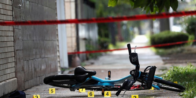 Chicago Police shell casing markers where a 37-year-old man riding a bicycle was shot and pronounced dead at the hospital, on the West Side of Chicago, Ill., July 26, 2020. (REUTERS/Shannon Stapleton)