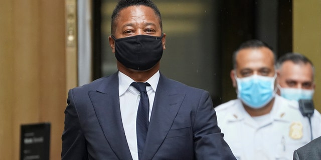 Cuba Gooding Jr. leaves court after a hearing in Gooding's sexual misconduct case, Thursday, Aug. 13, 2020, in New York. A judge ordered the courtroom outfitted with Plexiglas and other measures to prevent the spread of the coronavirus, which has delayed the trial indefinitely. (AP Photo/John Minchillo)