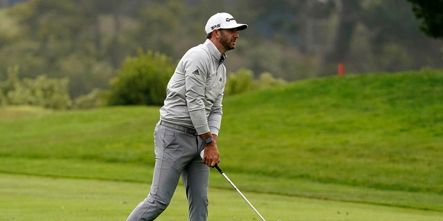 Dustin Johnson hits from the fairway on the 18th hole during the third round of the PGA Championship golf tournament at TPC Harding Park Saturday, Aug. 8, 2020, in San Francisco. (Associated Press)
