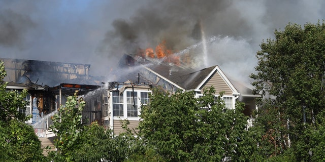 The three-story, garden-style complex was up in flames when first responders arrived at the scene, with heavy smoke and fire billowing from the rear from the structure.