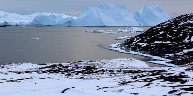 Icebergs near Greenland form from ice that has broken off--or calved--from glaciers on the island. A new study shows that the glaciers are losing ice rapidly enough that, even if global warming were to stop, Greenland's glaciers would continue to shrink. (Credit: Michalea King)