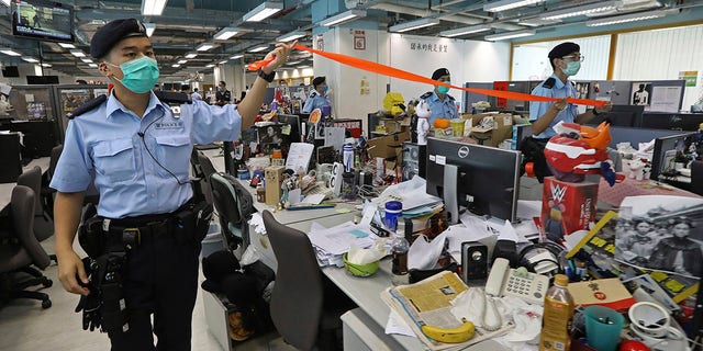 Hong Kong police arrested Lai and raided the publisher's headquarters Monday in the highest-profile use yet of the new national security law Beijing imposed on the city after protests last year. (Apple Daily via AP)