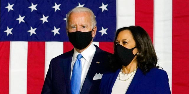 Democratic presidential candidate former Vice President Joe Biden and his running mate, Sen. Kamala Harris, D-Calif., arrive to speak at a news conference at Alexis Dupont High School in Wilmington, Del., Wednesday, Aug. 12, 2020. Biden and Harris both made comments suggesting Trump may push an unsafe coronavirus vaccine on the American people. (AP Photo/Carolyn Kaster)