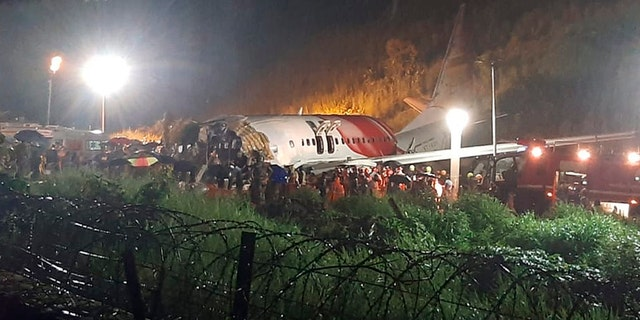 The Air India Express flight that skidded off a runway while landing at the airport in Kozhikode, Kerala state, India, Friday, Aug. 7, 2020. (Associated Press)