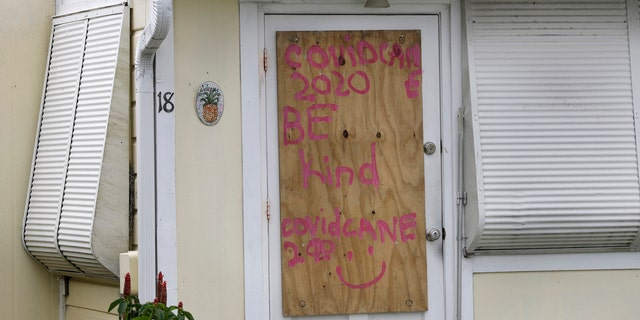 A boarded-up home is shown, Saturday, Aug. 1, 2020, in Briny Breezes, Fla.