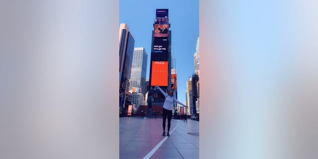 Julie Sullivan pauses for a photo in Times Square. (Photo credit: Julie Sullivan)