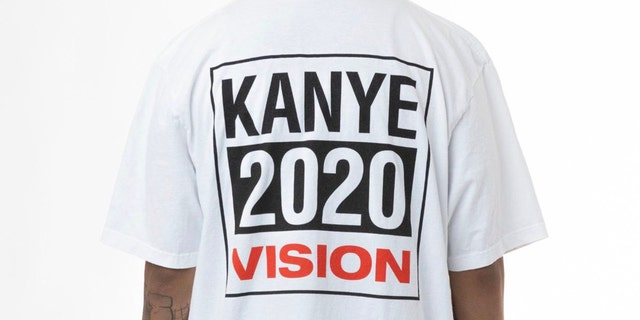 """A white T-shirt with a block-lettered logo reads """"Kanye 2020 vision."""""""