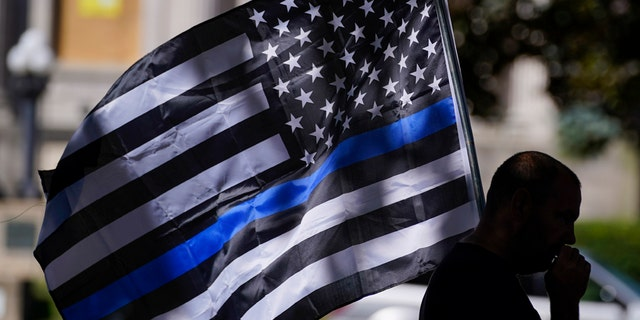 An unidentified man participating in a Blue Lives Matter rally Sunday in Kenosha, Wis.